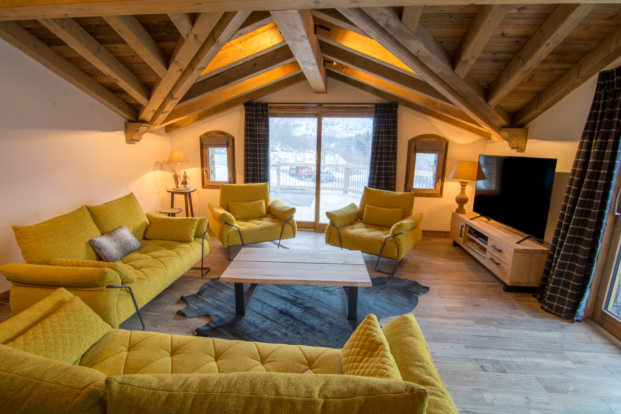 Luxury Chalet Saint Pères' living area with log fire